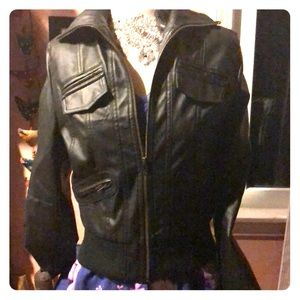 Leather jacket. Faux. With silky leopard lining.